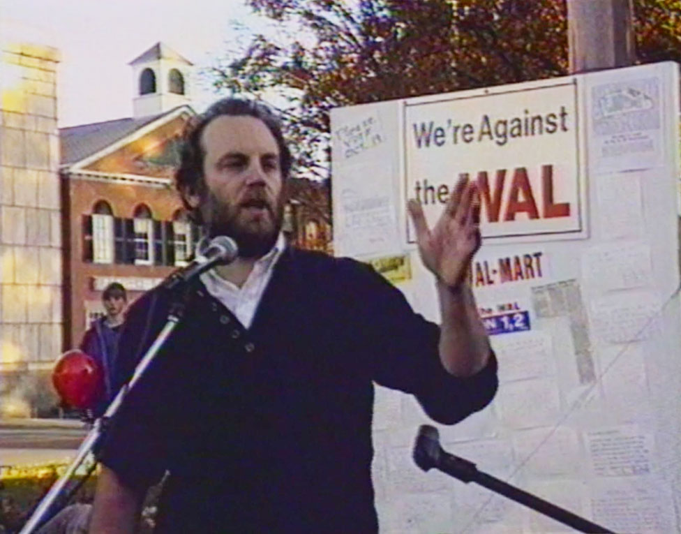 Al Norman delivers a speech at an anti-Walmart march