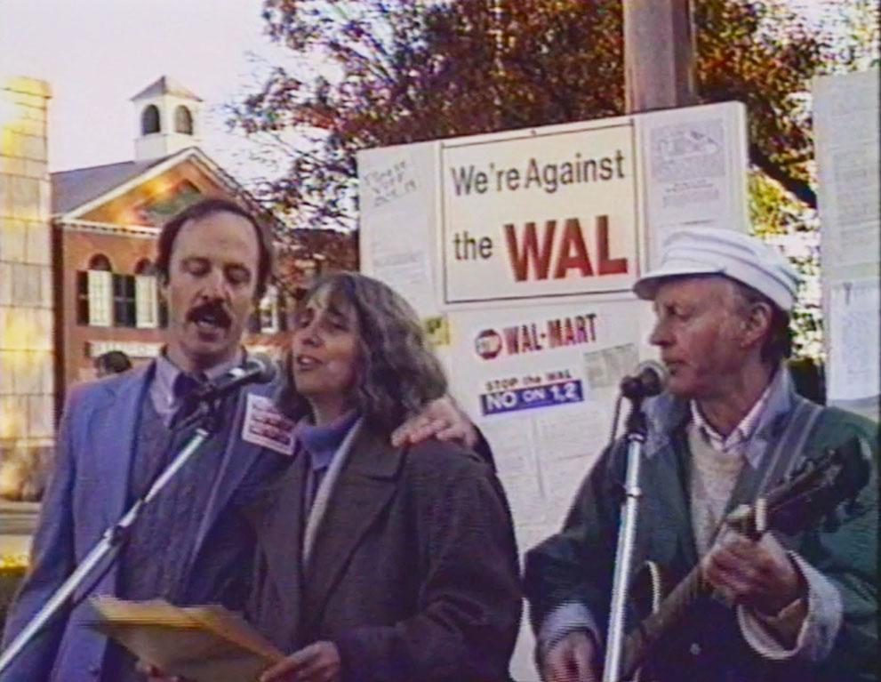 Protestors sing at an anti-Walmart protest