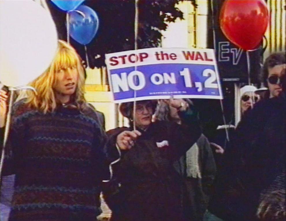 Protestors attend an anti-Walmart march