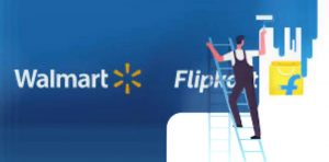 A painter covers up the name Flipkart with a Wal-mart logo
